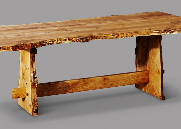 Angled shot of the pippy Oak dining I made using locally sourced Oak. clearly shoes the tennon going through the table leg.